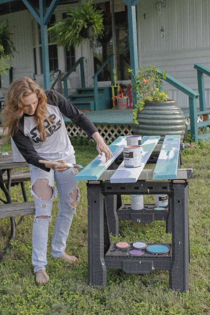 Artist Erika Rachel painting at the inn between